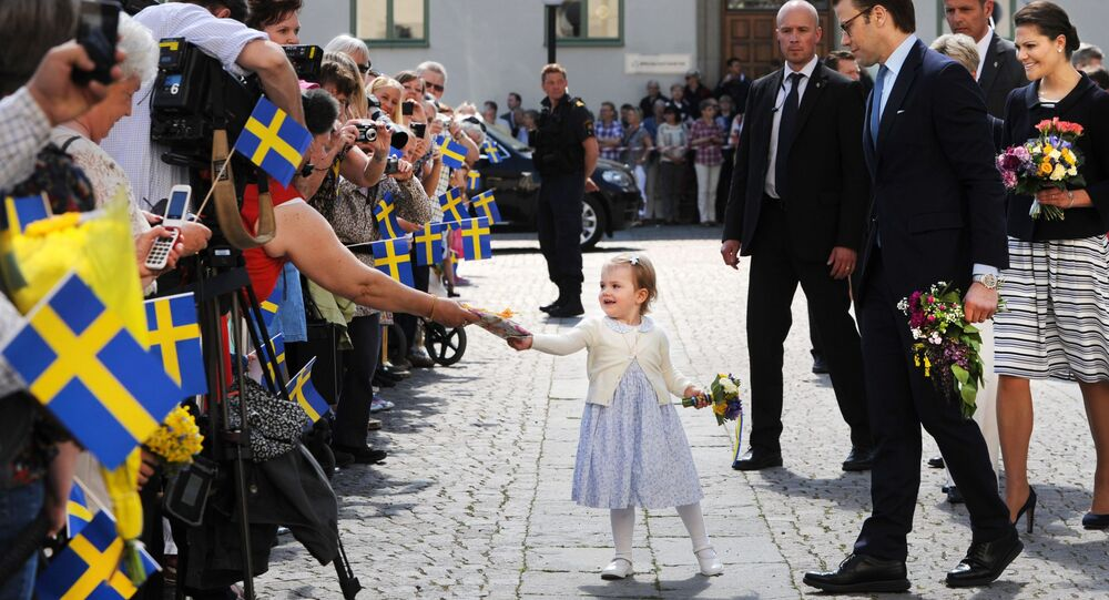 Sweden's Crown Princess Victoria, right, Prince Daniel, second right, and their daughter Princess Estelle