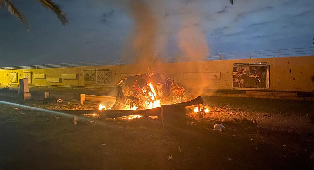 A picture shows a destroyed vehicle on fire following a US strike on January 3, 2020 on Baghdad international airport road in which top Iranian commander Qasem Soleimani was killed