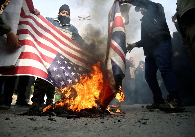 Demonstrators burn the US and British flags during a protest against the assassination of the Iranian Major-General Qassem Soleimani, head of the elite Quds Force.