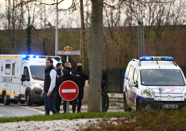 Police stand near a park in the south of Paris' suburban city of Villejuif on January 3, 2020 where police shot dead a knife-wielding man who killed one person and injured at least two others. - The man had attacked several people in a park in Villejuif before he was neutralised, the Paris police department said. Sources close to the investigation told AFP one of the victims had later died. The attacker was shot dead by police in a neighbouring suburb. The attacker's motive has not been made clear.