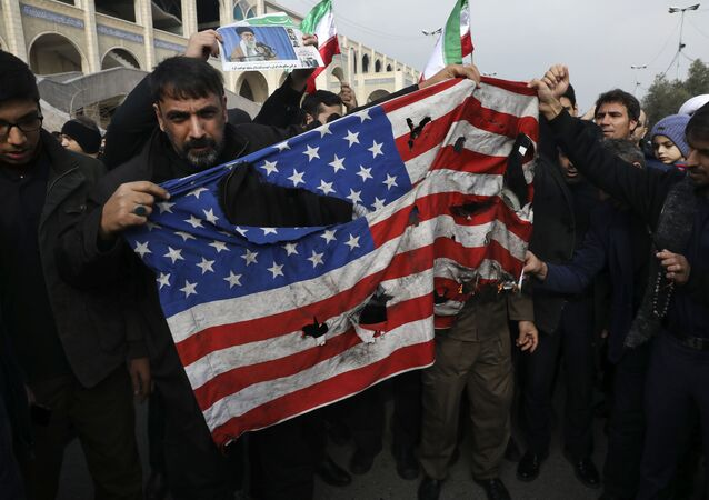 Protesters burn a U.S. flag during a demonstration over the U.S. airstrike in Iraq that killed Iranian Revolutionary Guard Gen. Qassem Soleimani, in Tehran, Iran, Jan. 3, 2020