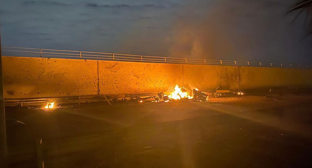 A picture shows a destroyed vehicle on fire following a US strike on January 3, 2020 on Baghdad international airport road in which top Iranian commander Qasem Soleimani was killed along with eight others, including the deputy head of Iraq's powerful Hashed al-Shaabi paramilitary force.