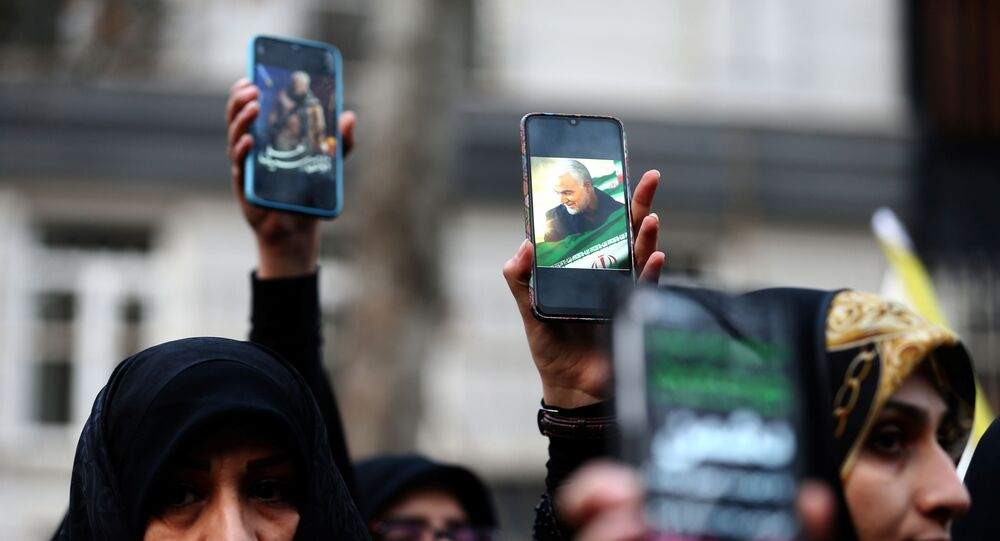 Iranian demonstrators hold up mobile phones showing the picture of the late Iranian Major-General Qassem Soleimani, during a protest against the assassination of Soleimani, head of the elite Quds Force, and Iraqi militia commander Abu Mahdi al-Muhandis, who were killed in an air strike at Baghdad airport, in front of the UN office in Tehran, Iran, 3 January 2020.