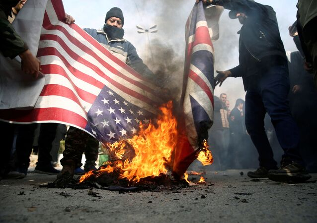 Demonstrators in Tehran, Iran burn US and British flags during a protest against the assassination of Iranian Major-General Qassem Soleimani, head of the elite Quds Force, and Iraqi militia commander Abu Mahdi al-Muhandis, who were killed in an air strike in Baghdad International Airport, 3 January 2020