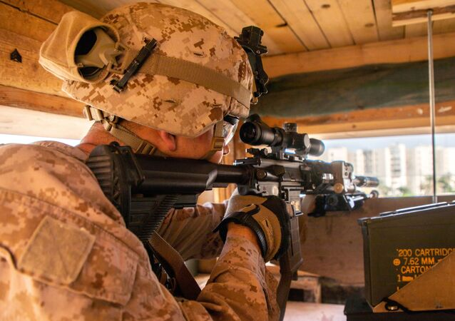 U.S. Marines with 2nd Battalion, 7th Marines, assigned to the Special Purpose Marine Air-Ground Task Force-Crisis Response-Central Command (SPMAGTF-CR-CC) 19.2, reinforce the U.S. Embassy Compound in Baghdad, Iraq, January 2, 2020. Picture taken January 2, 2020.