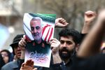 Iranian demonstrators chant slogans during a protest against the assassination of the Iranian Major-General Qassem Soleimani, head of the elite Quds Force, and Iraqi militia commander Abu Mahdi al-Muhandis, who were killed in an air strike at Baghdad airport, in front of United Nation office in Tehran, Iran January 3, 2020.