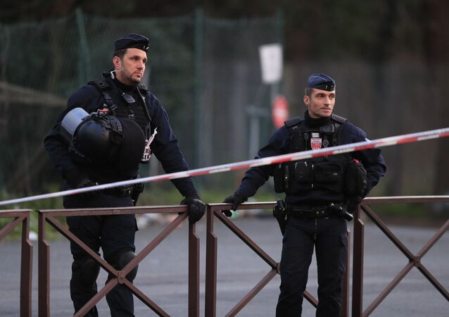 Riot police officers stand after a man attacked passerby Friday Jan.3, 2020 in Villejuif, south of Paris. A man armed with a knife rampaged through a Paris park attacking passers-by seemingly at random Friday, killing at least one person and injuring two others before police shot him dead, officials said.