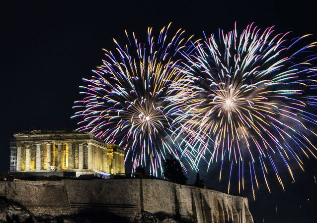 Fireworks explode over the ancient temple of the Parthenon on top of the Acropolis hill as part of Greece's celebrations for the New Year in Athens on January 1, 2020.