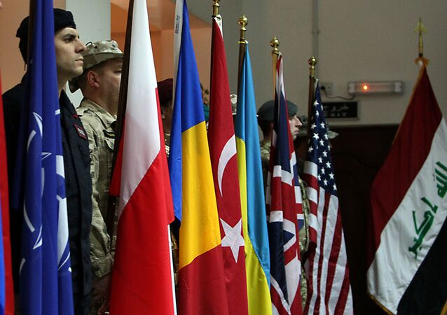 NATO soldiers stand to attention during a ceremony in the Iraqi capital Baghdad
