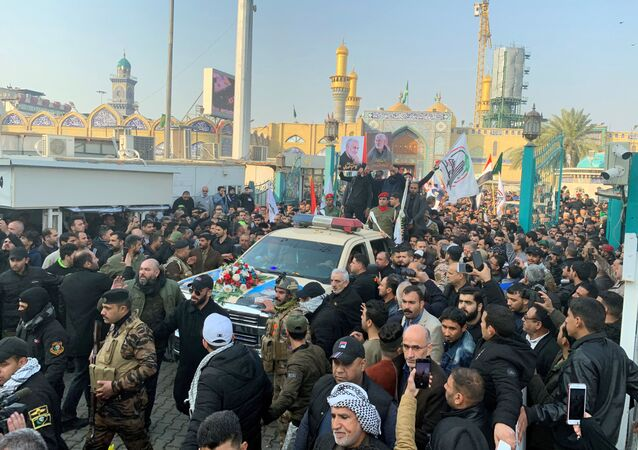 People gather at the funeral of the Iranian Major-General Qassem Soleimani, top commander of the elite Quds Force of the Revolutionary Guards, and the Iraqi militia commander Abu Mahdi al-Muhandis, who were killed in an air strike at Baghdad airport, in Baghdad, Iraq, January 4, 2020. REUTERS/Wissm al-Okili