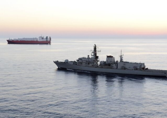 British navy vessel HMS Montrose escorts another ship