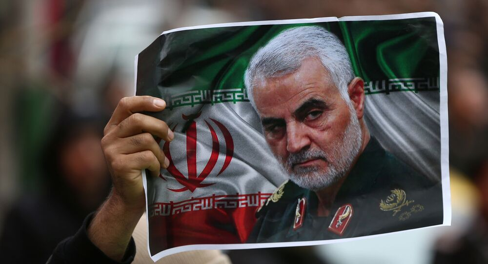 An Iranian holds a picture of late General Qassem Soleimani, head of the elite Quds Force, who was killed in an air strike at Baghdad airport, as people gather to mourn him in Tehran, Iran January 4, 2020.