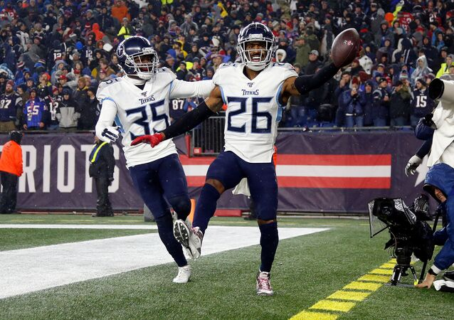 Jan 4, 2020; Foxborough, Massachusetts, USA;  Tennessee Titans cornerback Logan Ryan (26) celebrates with defensive back Tramaine Brock (35) after scoring a touchdown on an interception against the New England Patriots during the second half at Gillette Stadium. Mandatory Credit: Winslow Townson-USA TODAY Sports