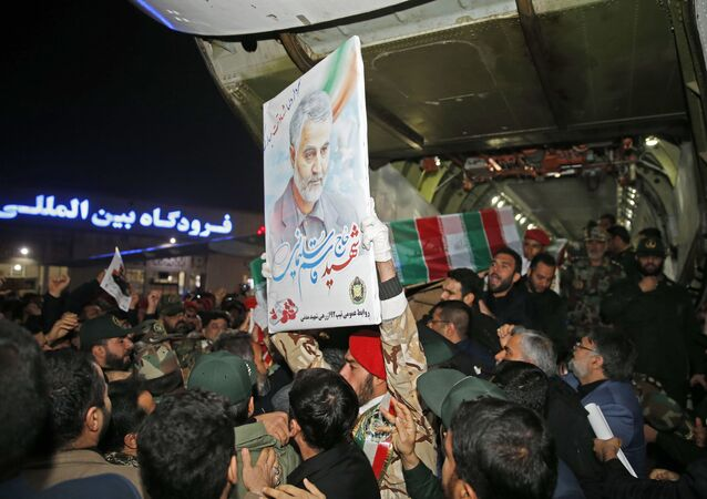 People carry the casket of Iranian commander Qasem Soleimani upon arrival at Ahvaz International Airport in southwestern Iran on January 5, 2020.