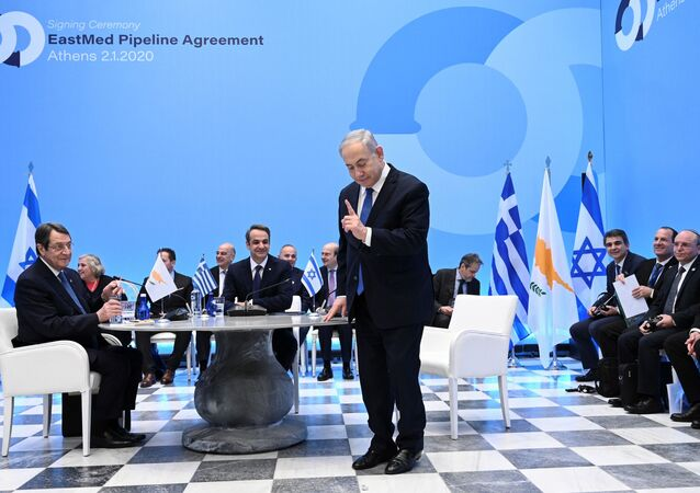Greek Prime Minister Kyriakos Mitsotakis (C), his Israeli counterpart Benjamin Netanyahu (R) and Cypriot President Nikos Anastasiadis attend the signing of an agreement for the EastMed pipeline project designed to ship gas from the eastern Mediterranean to Europe in Athens on January 2, 2020.