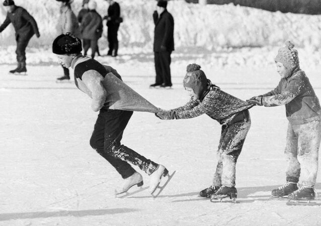 Children have fun on a skating rink in Moscow, 1976