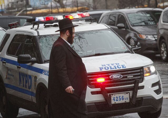 A NYPD car patrols in South Williamsburg Brooklyn on December 30, 2019 in New York City, two days after an intruder wounded five people at a rabbi's house in Monsey, New York during a gathering to celebrate the Jewish festival of Hanukkah.