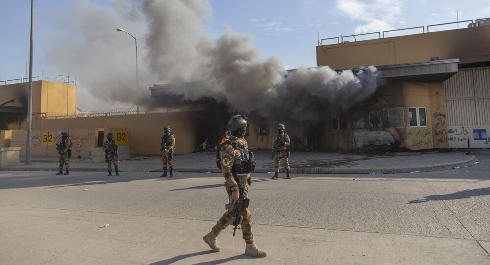 Iraqi army soldiers are deployed in front of the US embassy in Baghdad.
