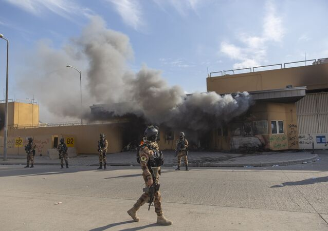 Iraqi army soldiers are deployed in front of the U.S. embassy, in Baghdad