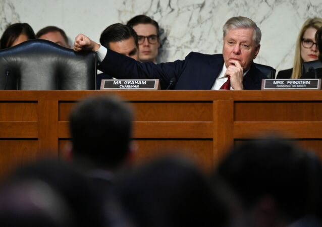 Sen. Lindsey Graham (R-SC) listens as U.S. Justice Department Inspector General Michael Horowitz (not pictured)  testifies before a Senate Judiciary Committee hearing Examining the Inspector General's report on alleged abuses of the Foreign Intelligence Surveillance Act (FISA) on Capitol Hill in Washington, U.S., December 11, 2019.