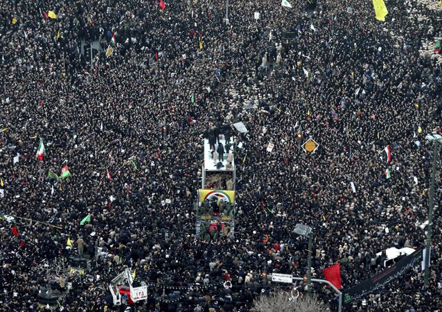 Coffins of Gen. Qassem Soleimani and others who were killed in Iraq by a U.S. drone strike, are carried on a truck surrounded by mourners