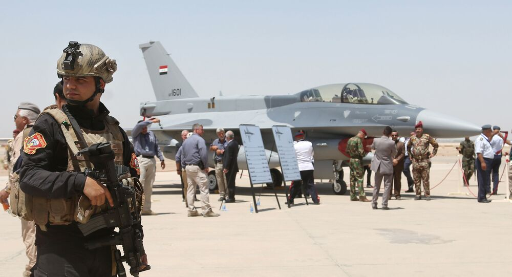 raqi SWAT team stands guard as security forces and others gather next to a U.S.- made F-16 fighter jet during the delivery ceremony at Balad air base