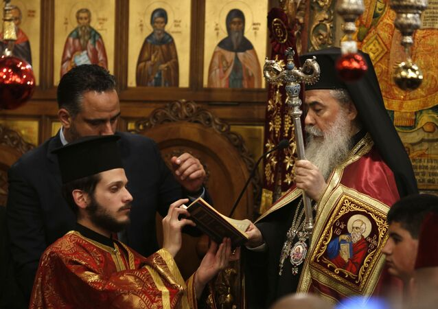 Greek Orthodox Patriarch of Jerusalem Theophilos III holds mass in the Church of the Nativity, built atop the site where Christians believe Jesus Christ was born, to celebrate Christmas according to the Eastern Orthodox calendar, in the West Bank City of Bethlehem, Sunday, Jan. 6, 2019.