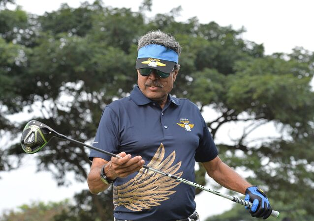 Former cricketer and golfer Kapil Dev looks on before playing a shot during the third edition of the Krishnapatnam Port Golden Eagles Golf Championship held at the Presitige Golfshire Club on the outskirts of Bangalore on November 4, 2017.