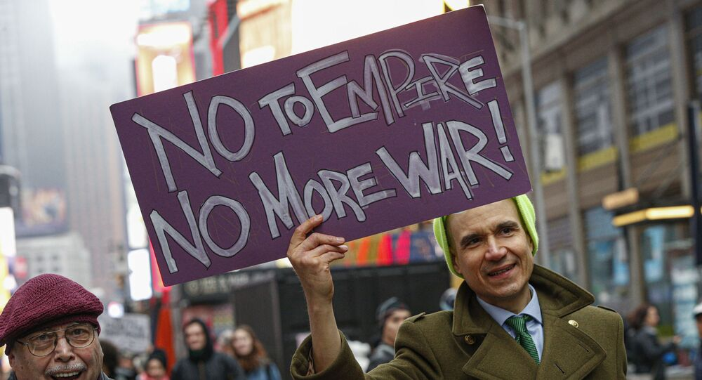 A man joins the anti-war protest at Times Square in New York on January 4, 2020. - Demonstrators are protesting the US drone attack which killed Iran's Major General Qasem Soleimani in Iraq on January 3, a dramatic escalation in spiralling tensions between Iran and the US, which pledged to send thousands more troops to the region.