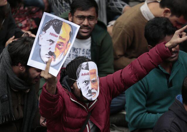Students shout slogans inside the Jawaharlal Nehru University in New Delhi, India, Monday, Jan. 6, 2020.