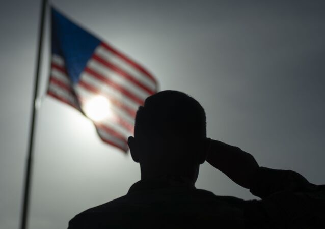 This US Air Force file photo obtained January 5, 2020 shows US Air Force Staff Sgt. Devin Boyer, 435th Air Expeditionary Wing photojournalist, as he salutes the flag at Camp Simba, Kenya, on August 26, 2019.