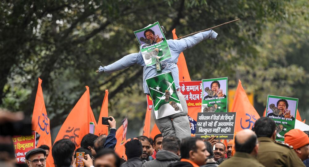 Activists of National Sikh Sangat and other right-wing Hindu organisations hold an effigy of Pakistan's Prime Minister Imran Khan (C) to protest against the attack by a mob on the Gurdwara Nankana Sahib Sikh shrine in Pakistan, during a demonstration near the Pakistan Embassy in New Delhi on January 7, 2020.