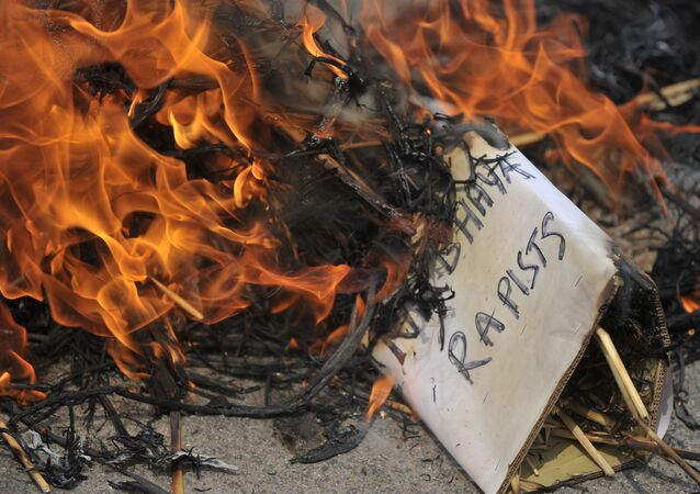 Activists of the Communists Party of India(CPI) burn an effigy representing the rapists of Delhi student, Nirbhaya during their protest in Hyderabad on March 6, 2015.