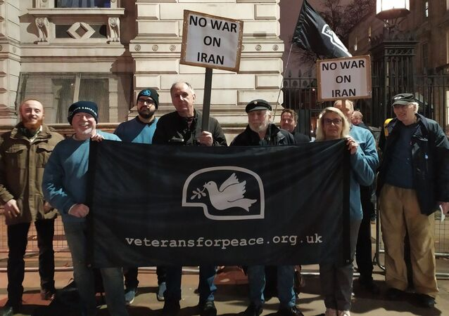 Veterans for Peace UK members stand infront of 10 Downing Street on 7 July 2020 in opposition to war with Iran