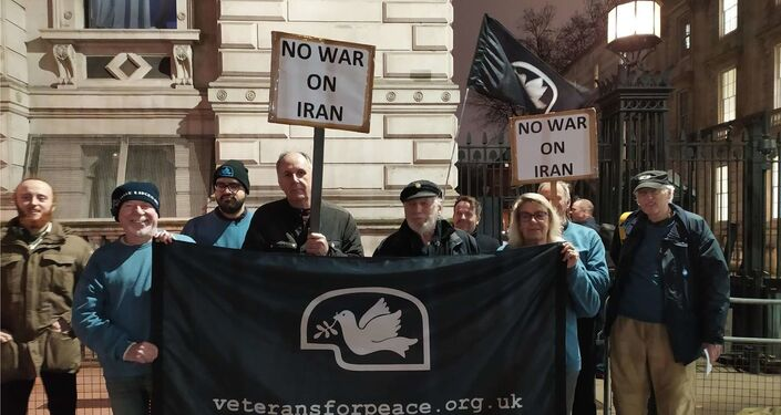 Veterans for Peace UK members stand in front of 10 Downing Street on 7 July 2020 in opposition to war with Iran
