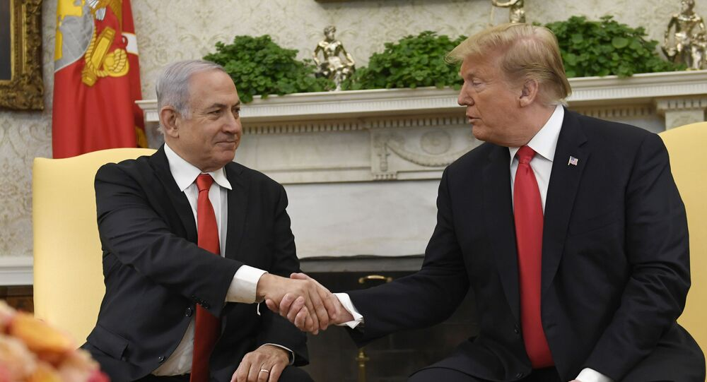 President Donald Trump, right, and Israeli Prime Minister Benjamin Netanyahu, left, shake hands in the Oval Office of the White House in Washington, Monday, March 25, 2019, at the beginning of their meeting.