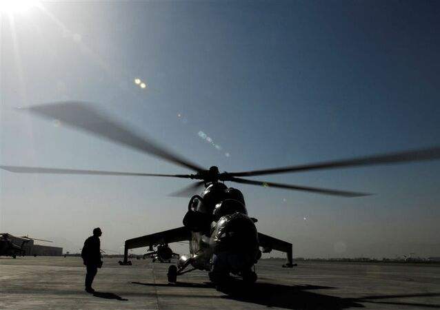 In this handout picture provided by the US Coalition Forces on June 29, 2009 and taken on May 27, 2009, a member of the Afghan Army Air Corps prepares to launch a MI-35 attack helicopter on a gunnery training mission at Kabul International Airport.