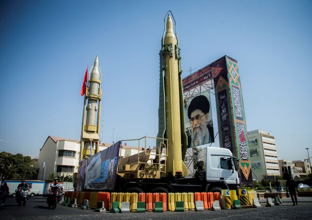 A display featuring missiles and a portrait of Iran's Supreme Leader Ayatollah Ali Khamenei is seen at Baharestan Square in Tehran, Iran