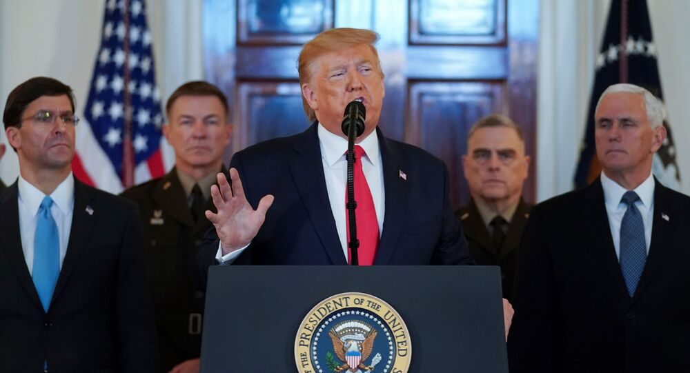 US President Donald Trump delivers a statement about Iran flanked by US Defense Secretary Mark Esper, Vice President Mike Pence and military leaders in the Grand Foyer of the White House in Washington, 8 January 2020.