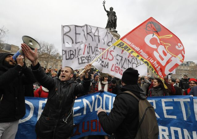 Protestors hold banners during a demonstration called by French national trade union General Confederation of Labour (CGT) against the pension reform on January 4, 2020, on the Place de la Republique in Paris