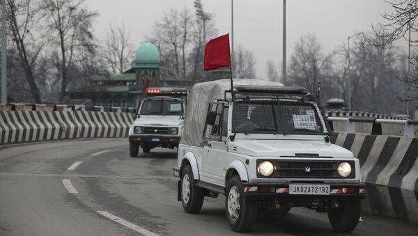 Security vehicles of Indian police guard a convoy of New Delhi-based diplomats passing through Srinagar, Indian controlled Kashmir, Thursday, Jan. 9, 2020 - Sputnik International
