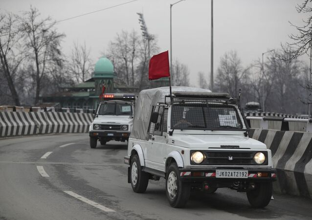 Security vehicles of Indian police guard a convoy of New Delhi-based diplomats passing through Srinagar, Indian controlled Kashmir, Thursday, Jan. 9, 2020