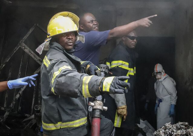 Rescuers attend the scene of an aircraft operated by private carrier Busy Bee which crashed in Goma, Congo Sunday, Nov. 24, 2019
