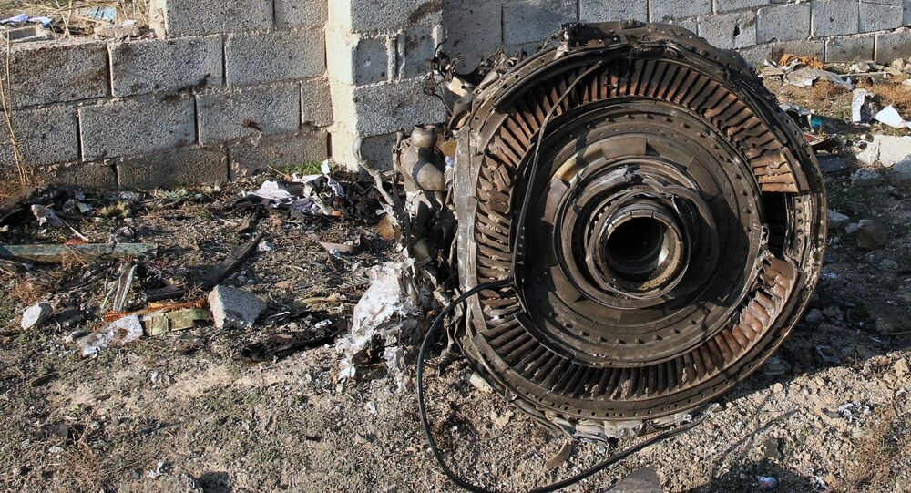 EDITORS NOTE: Graphic content / An engine lies on the ground after a Ukrainian plane carrying 176 passengers crashed near Imam Khomeini airport in the Iranian capital Tehran early in the morning on January 8, 2020, killing everyone on board
