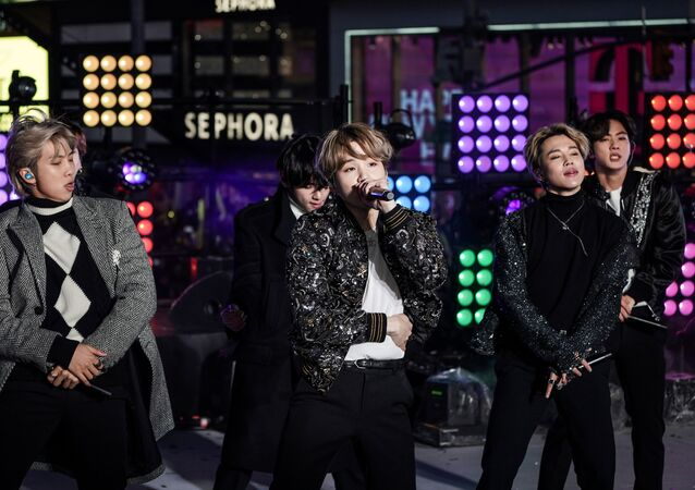 Suga is seen in the centre as BTS performs during New Year's Eve celebrations in Times Square