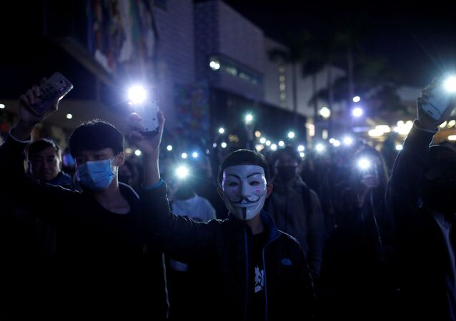 Students hold up their mobile phones during an anti-government protest in Hong Kong, China December 13, 2019