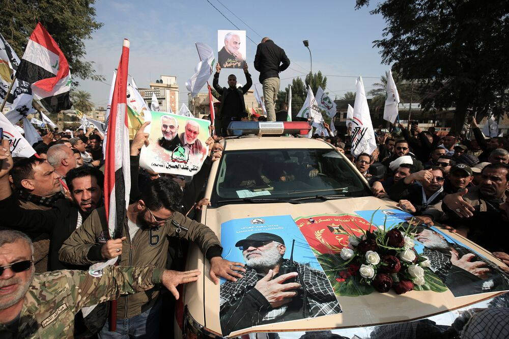 Mourners surround a car carrying the coffin of Iraqi paramilitary chief Abu Mahdi al-Muhandis during a funeral procession for him and nine others in Baghdad's district of al-Jadriya, near the high-security Green Zone, on 4 January 2020.