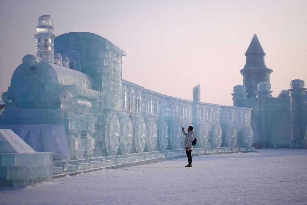A man visits ice sculptures ahead of the annual Harbin International Ice and Snow Sculpture Festival in the northern city of Harbin, Heilongjiang province, China on 4 January 2020.
