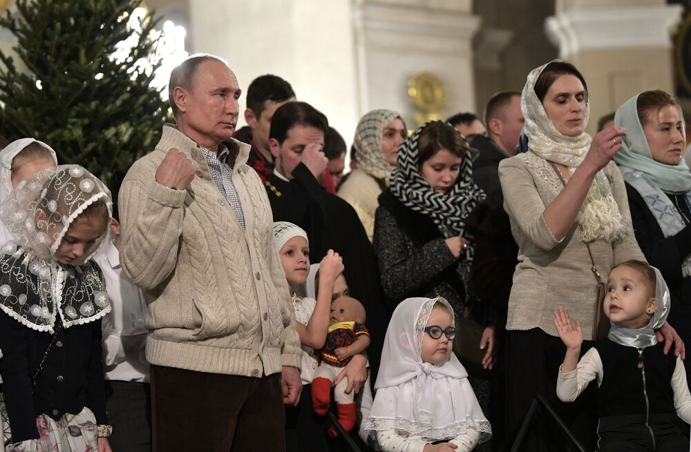 Russian President at a Christmas service at Transfiguration Cathedral, Saint Petersburg.