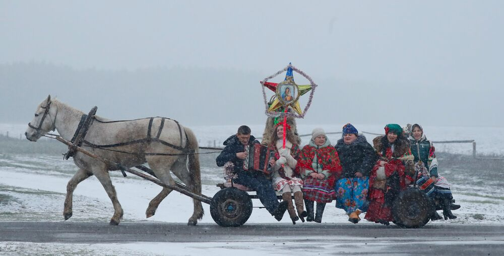 People celebrate a rite called Kolyadki, a pagan winter holiday which over the centuries has merged with Orthodox Christmas celebrations in some parts of Belarus, in the village of Dubovka, Belarus on 7 January 2020.